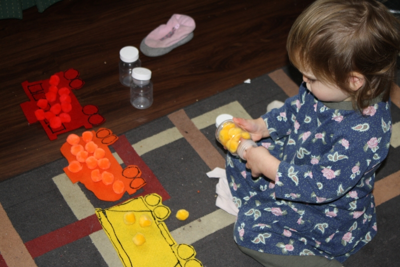 "Tirzah Mae plays with her ""Freight Train"" activity"