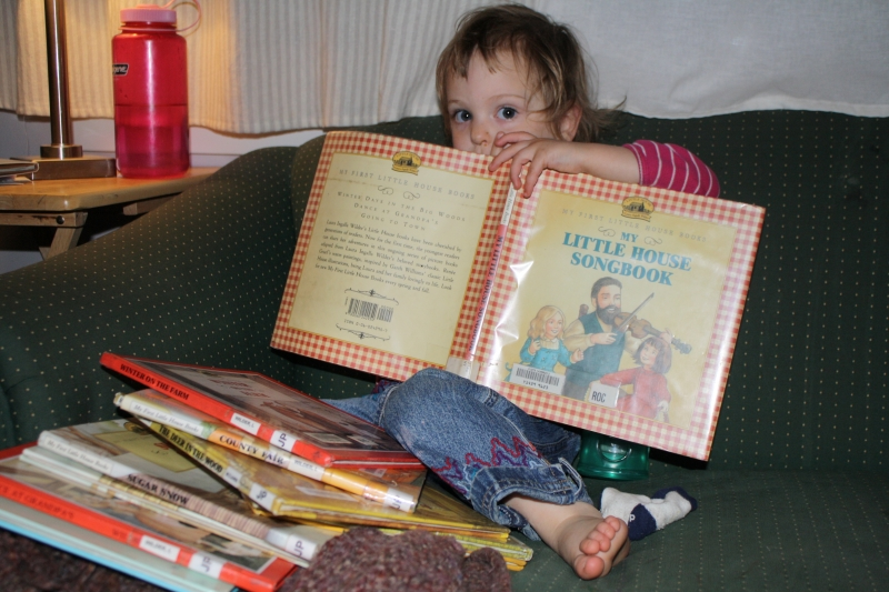 "Tirzah Mae and her favorite ""My First Little House Book"""