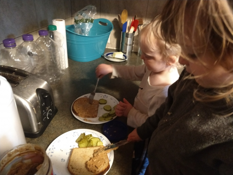 Making Peanut Butter and Dill Pickle Sandwiches