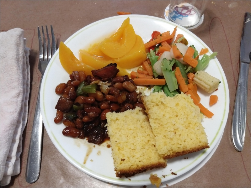 Baked beans, cornbread, stir fry veggies, and peaches