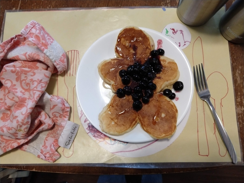 Pancake man with blueberries