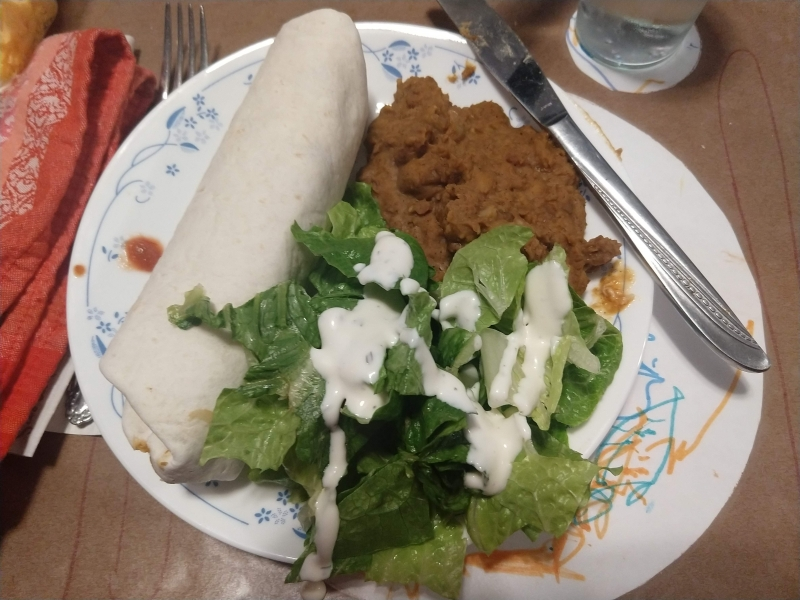 Salsa chicken burrito, non-refried beans, and lettuce salad