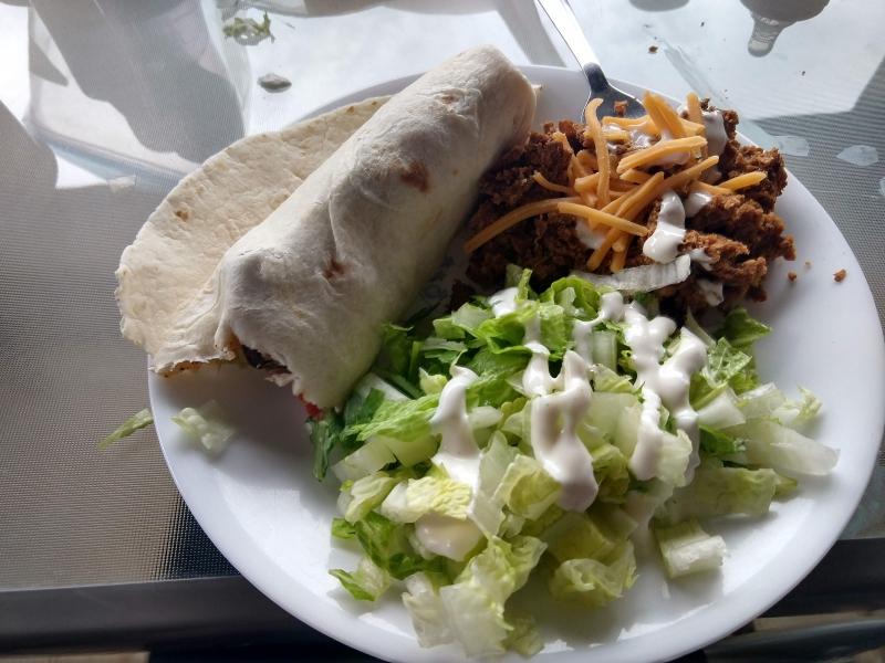Beef Fajitas, lettuce salad, burrito beans