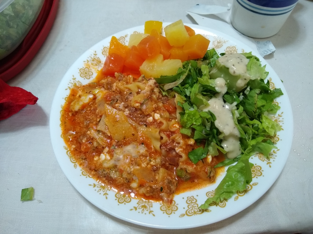 Lasagna, lettuce, and fruit