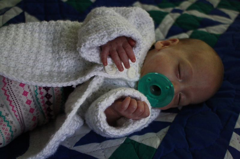 Tirzah Mae in the Sweater Grandma Crocheted for her