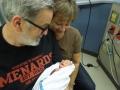 Grandma and Grandpa smile at Tirzah Mae