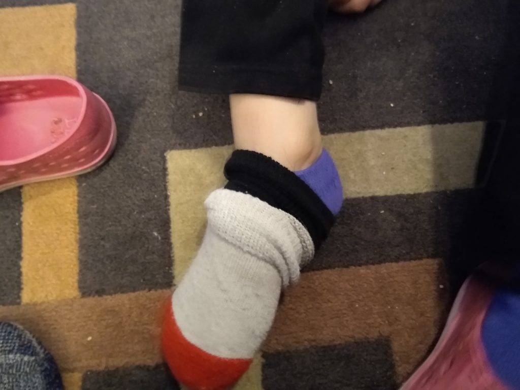 Beth-Ellen's foot with three pairs of socks