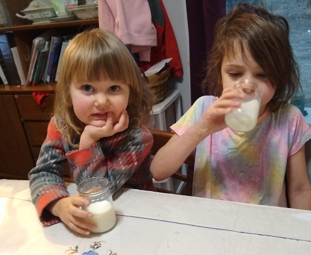 Tirzah Mae and Beth-Ellen drinking cow's milk