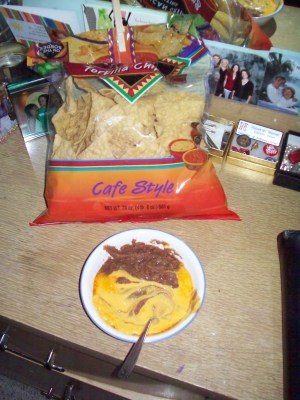 Tortilla chips and nacho cheese with beans