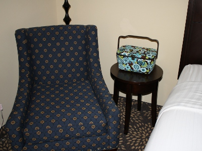 Sewing basket by hotel chair